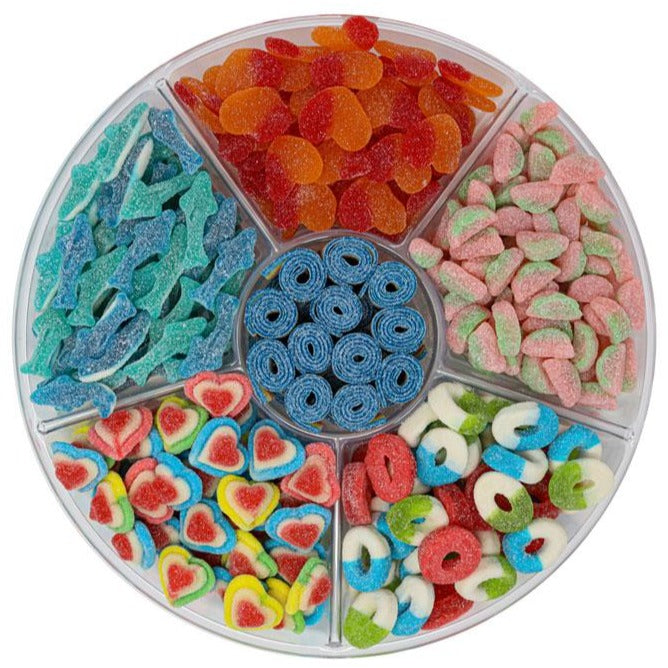 candy platter with sour triple layer hearts, sour belts, sour peach hearts, sour watermelon rinds, sour blue sharks and multi colored sour rings