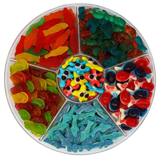 candy platter with gummy ocean blobs, assorted Swedish fish, gummy mermaid tails, gummy filled whales, sour sharks & chewy flavored flip flops and more.