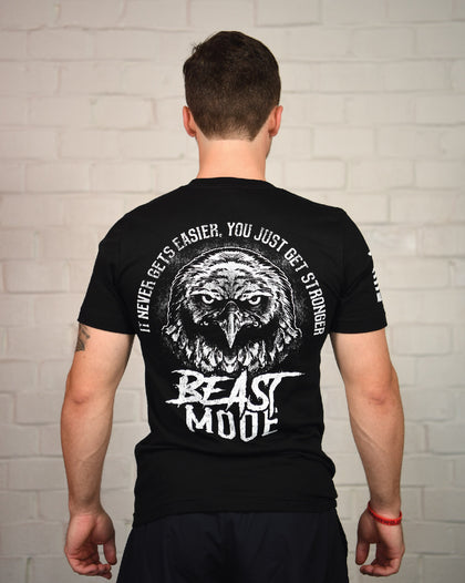 "Black short-sleeve t-shirt with the text ""It never gets easier, you just get stronger"" and ""beast mode"" surrounding the face of an Eagle."
