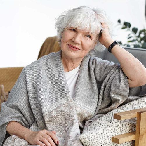 Older Woman sitting and looking at the camera