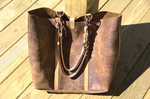 Wanderer shoulder bag  in the sun. Bright chestnut pull-up leather with natural veg-tanned and oiled straps.