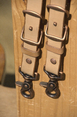 Oiled VegTan straps with antique copper chicago screws, clips and conway buckles.