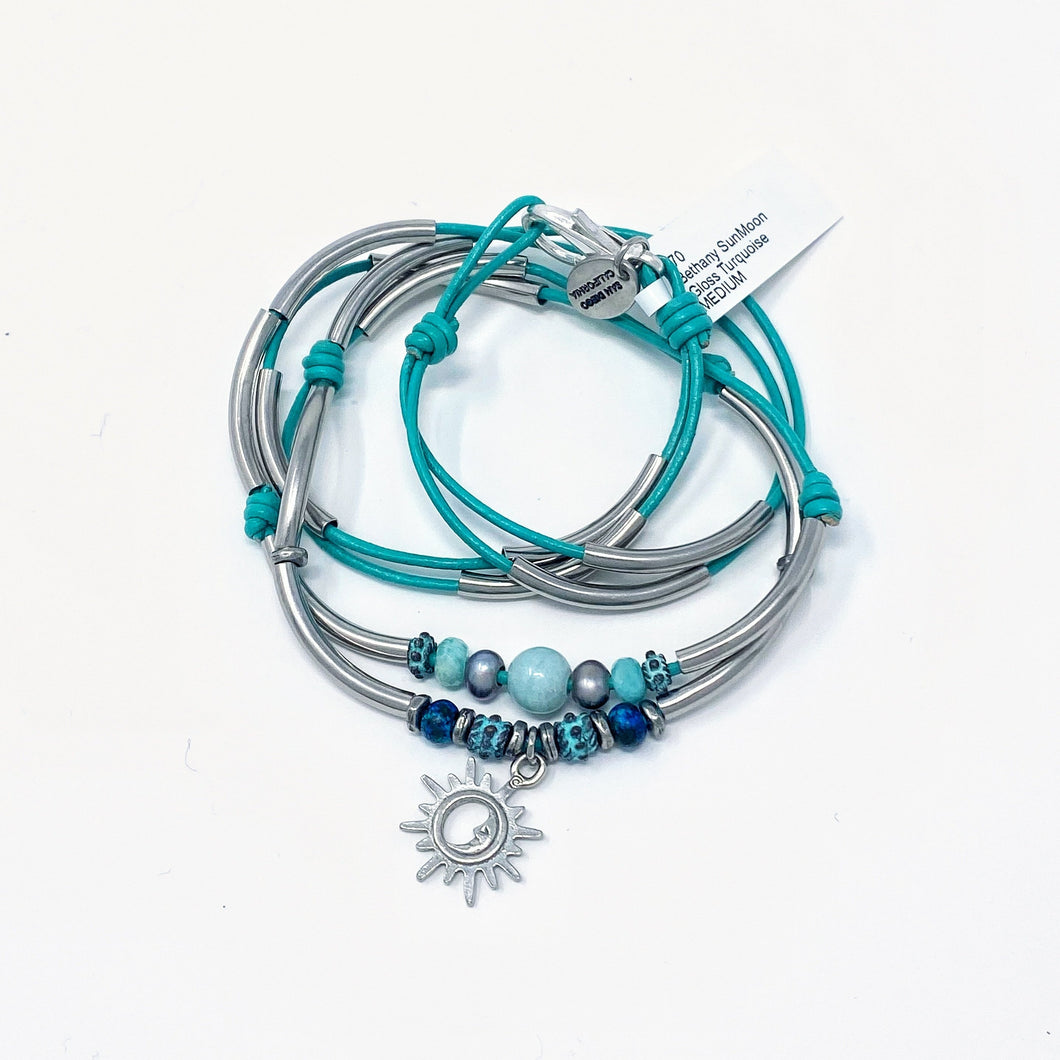 Lizzy James convertible necklace bracelet with sun/moon charm. Turquoise leather rope with sections of silver.