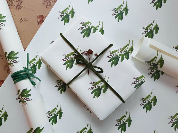 Green leaves wrapping paper on pure white paper
