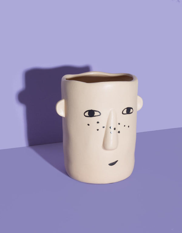 Ceramic vase with face print