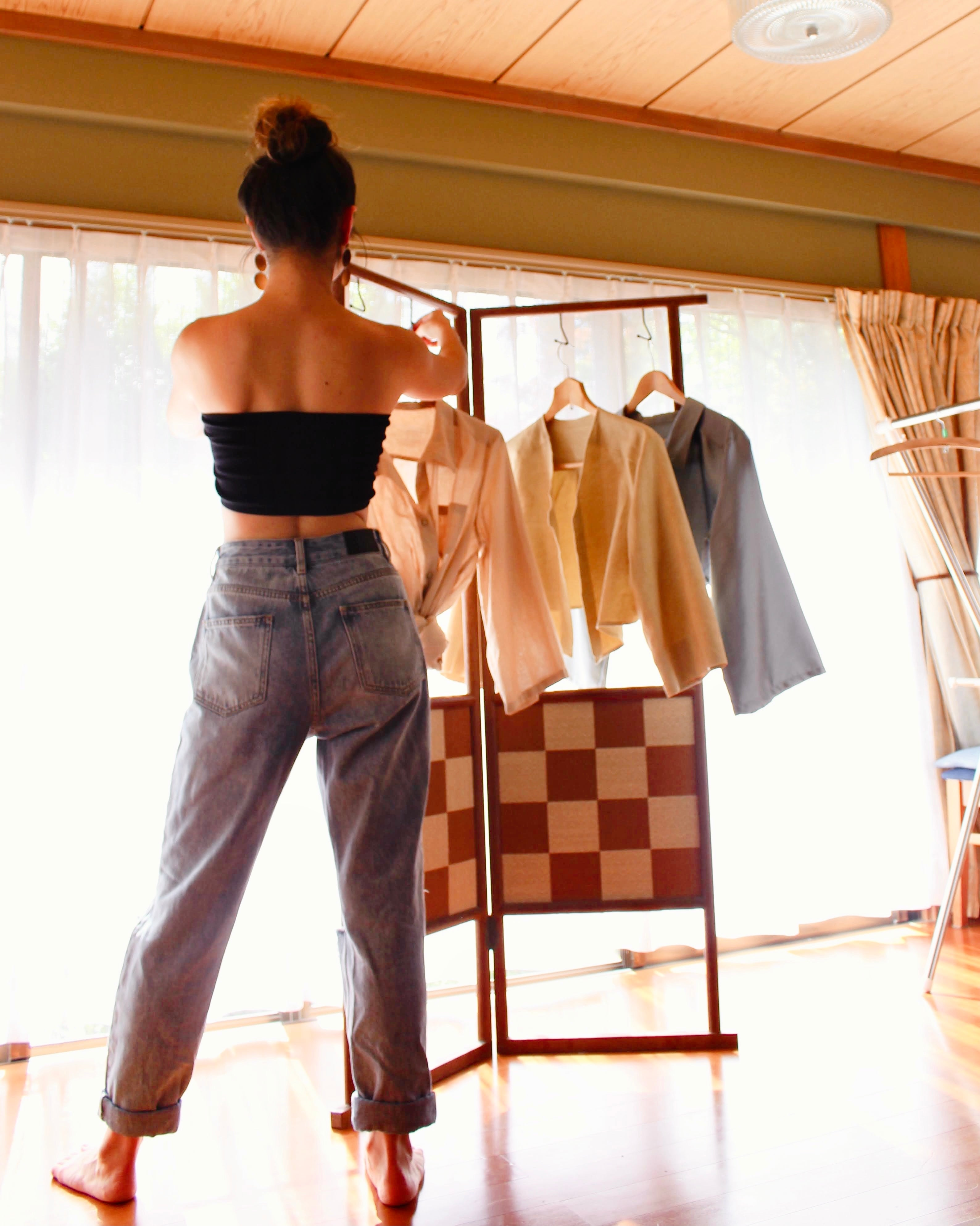 Girl hanging clothes doing laundry