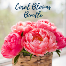 Load image into Gallery viewer, A rattan vase full of bright coral peonies.