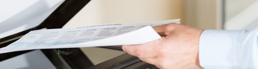 Employee scanning document on a copier
