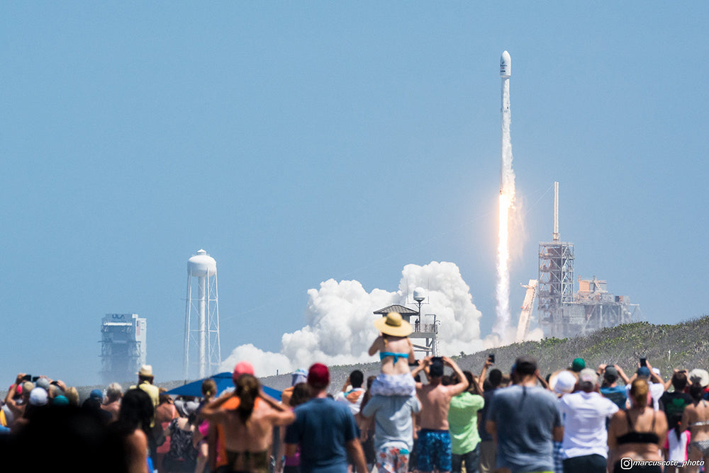 Spectators look on as Falcon Heavy lifts off for the first time ever from Pad 39-A in Florida.