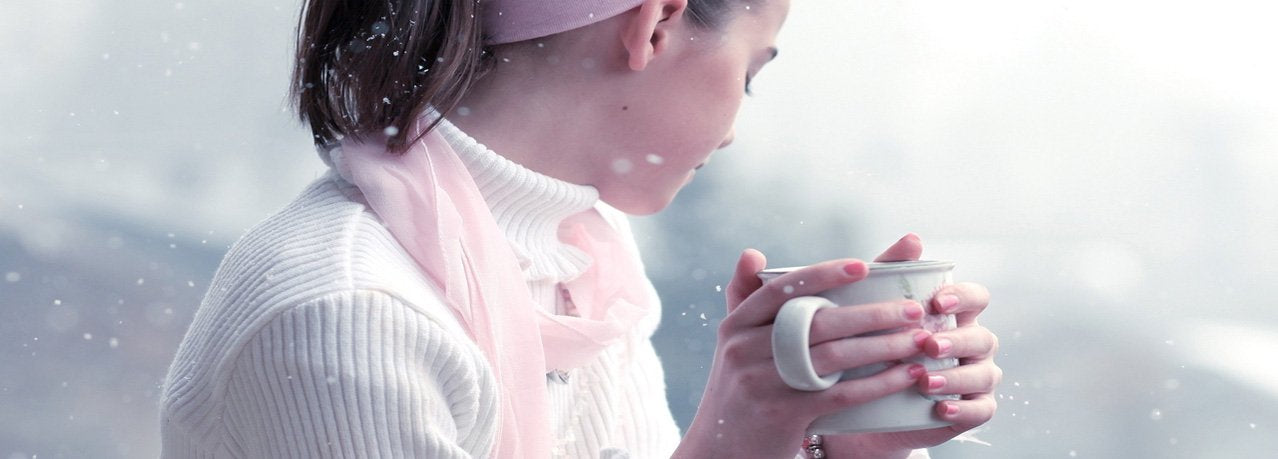 young woman drinking tea outside