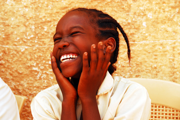 African girl laughing and happy.