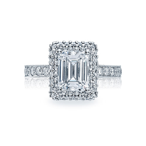 The elegance of an emerald center diamond is amped up by a spectacular double bloom of diamonds; framing and enhancing the center diamond. With strings of pav? diamonds and a beautiful; distinctive profile; this ring could be the one for you.
