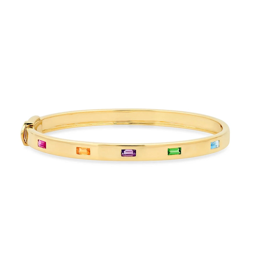 The Multi Colored Five Baguette Bangle is a bold and beautiful addition to your jewelry collection. With 0.67 carats of ruby, tsavorite, amethyst and sapphire, it gleams gold with a subtle pop of color. Whether on its own or stacked with other bracelets, the Bangle with Multi Colored Spaced Baguettes makes an unforgettable wrist statement.The Multi Colored Five Baguette Bangle can be made to order in white and rose gold upon request.
