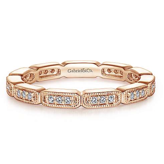 Add a little geometric dimension into your wedding band stack with this beautiful 14K rose gold diamond eternity band from Gabriel & Co.