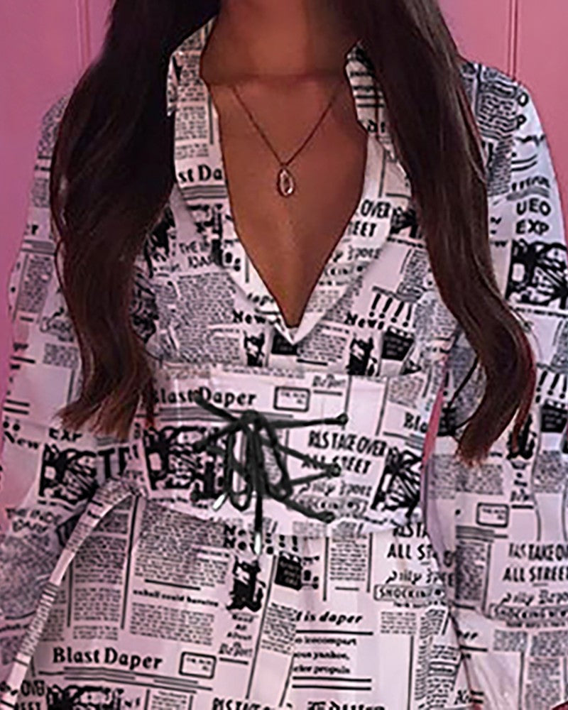 NOTCHED COLLAR NEWSPAPER PRINT LACE-UP SHIRT DRESS