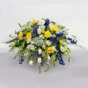 Blue, Yellow, White Casket Spray