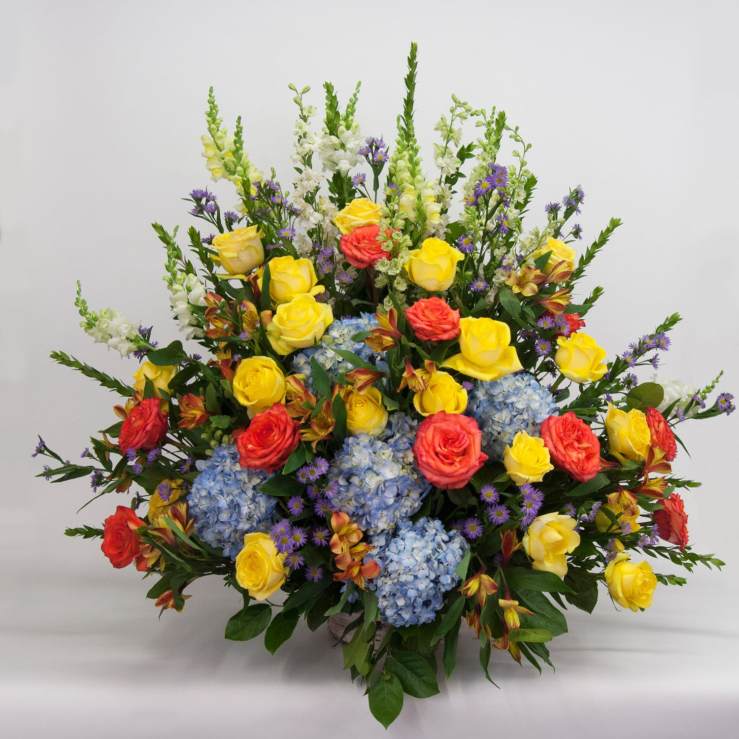 Orange, Yellow, Blue Sympathy Basket