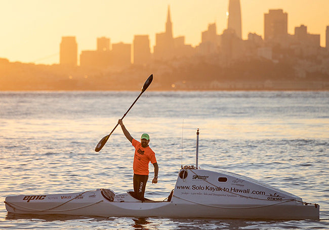 Image of Cyril Derreumaux with his kayak as he prepares for his journey, fueled by Standard Process Possible Bars.