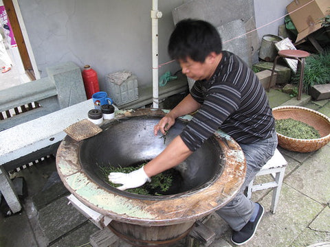 Firing longjing leaves