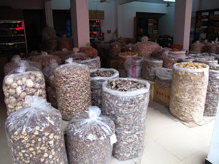 Sacks of wild forest mushrooms for sale