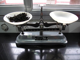 Weighing out 5g of tea for taste testing