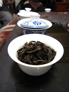 Learning the art of serving tea from a gaiwan
