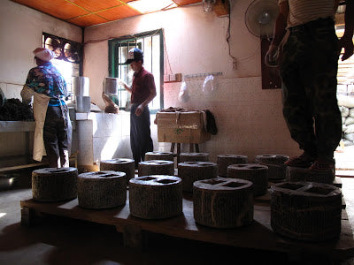 Stone presses used in Zhen Si Long's puer manufacture
