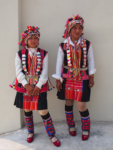 Hani minority girls in their colorful ceremonial costume, Bulang township