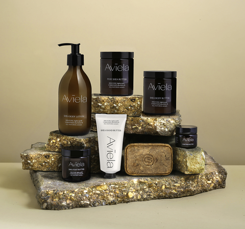 Aviela pure Shea Butter products displayed on a stone