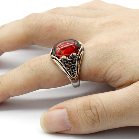 Zuringa men's pure sterling silver ring with a red garnet.