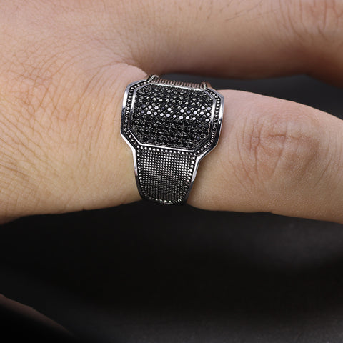 Zuringa hand crafted sterling silver ring with black zircon inset stones.