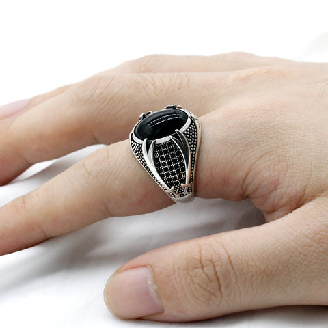Zuringa hand crafted black agate stone in a sterling silver, double sword sided ring.