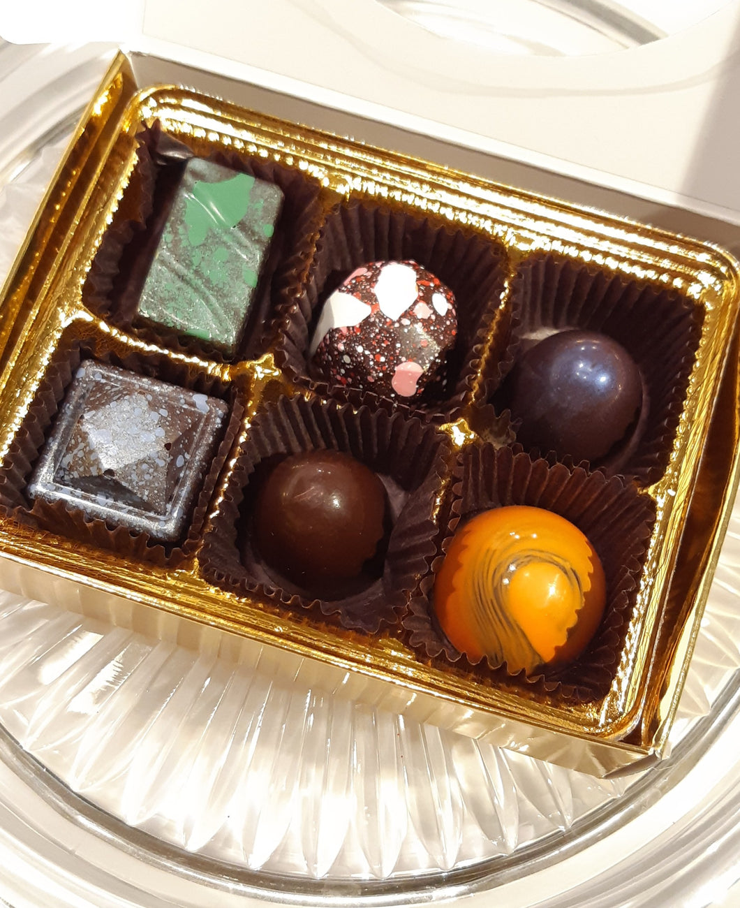 fine chocolates  Included in this selection are mint, vanilla caramel, brandy mango, plain, and orange. Culinary Creations by Mark Beacock, Brockville, ON