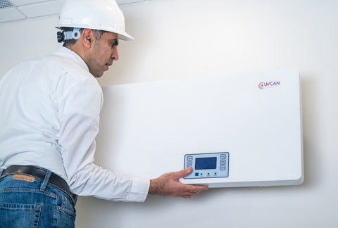 Servicer installing a Cosmos Wall Mount unit