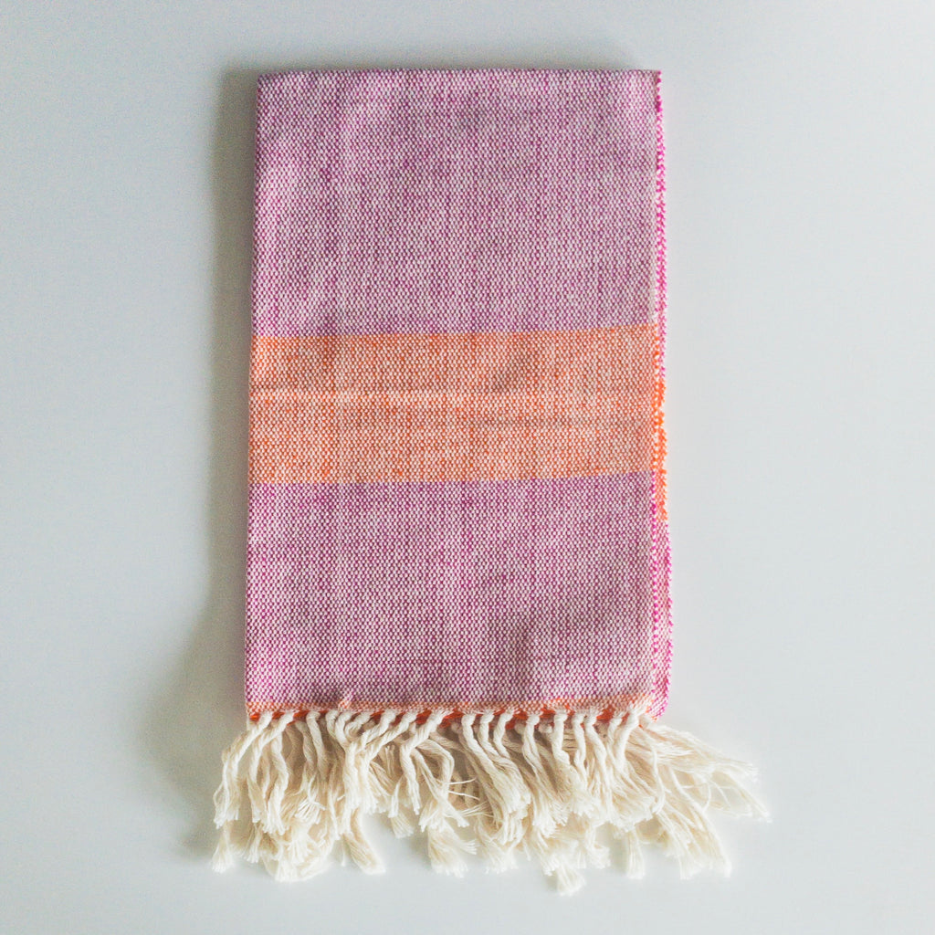 LIZABETH Hand Towel in sunrise handwoven by Living Threads Co. Partner artisans in Nicaragua in Fuchsia and Orange