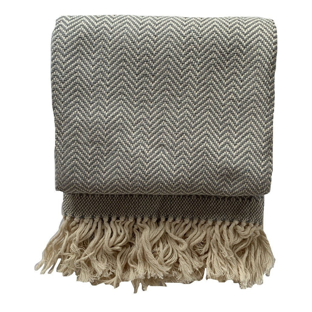Handmade cotton herringbone throw and blanket handmade by Living Threads Co. artisans in Nicaragua in Grey