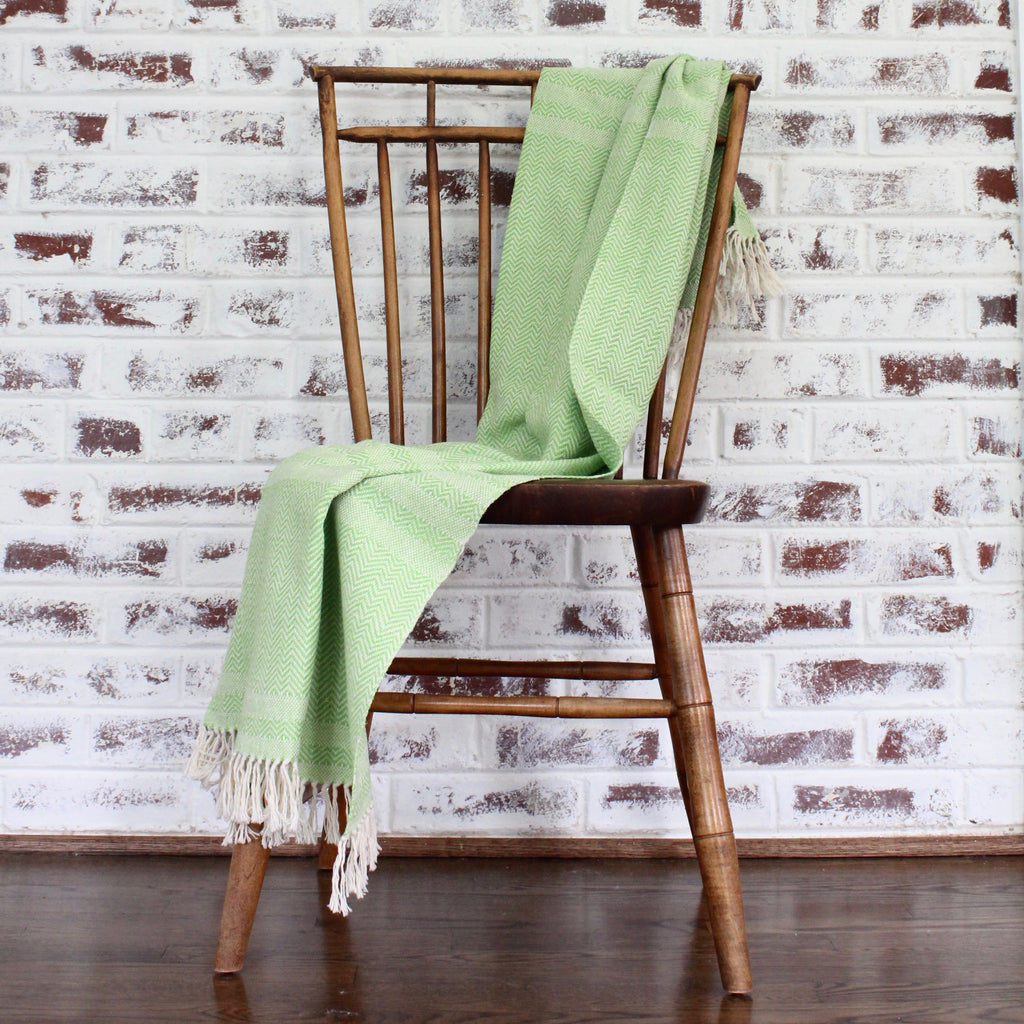 Mateo Herringbone handwoven throw in lime by Living Threads Co. artisans