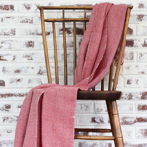 handwoven herringbone 100% ecologically dyed cotton blanket by Living Threads Co. artisans in red