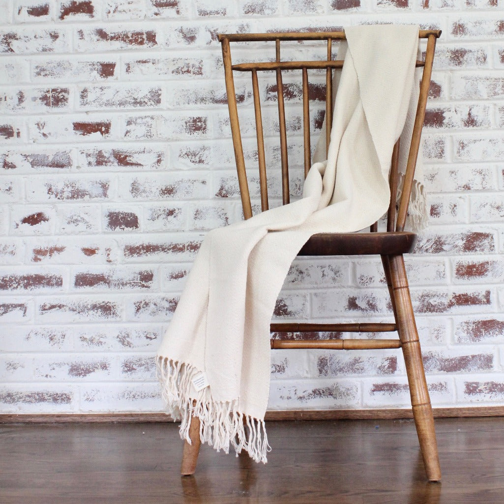 Handwoven herringbone 100% ecologically dyed cotton blanket by Living Threads Co. artisans in natural.
