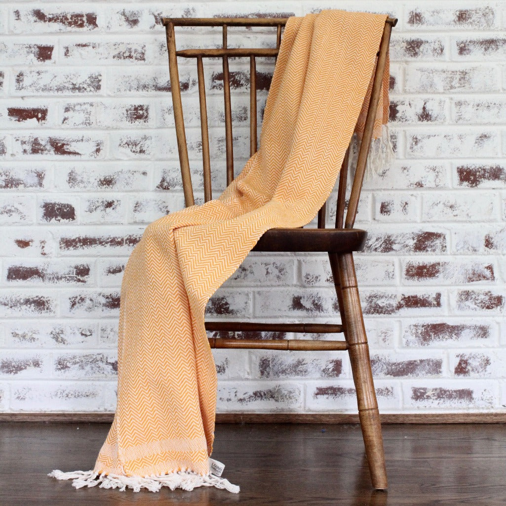 herringbone 100% ecologically dyed cotton blanket by Living Threads Co. in orange