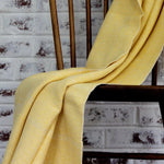 Living Threads Co. handwoven herringbone blanket in 100% ecologically dyed yellow cotton.
