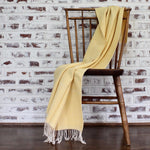 100% ecologically dyed yellow herringbone blanket in cotton handwoven by Living Threads Co. artisans.