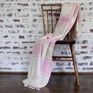 handwoven cotton AUDAZ blanket by Living Threads Co. artisans in pink