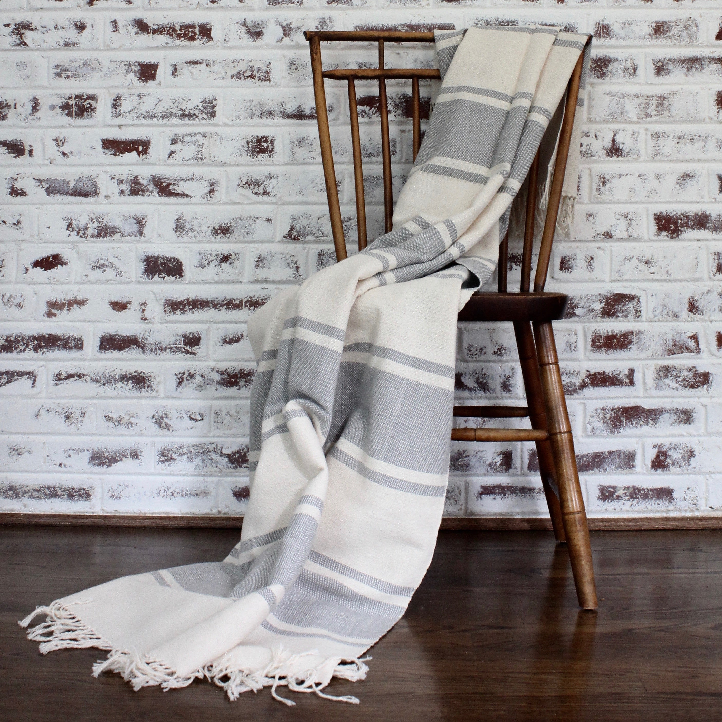 handwoven cotton AUDAZ blanket by Living Threads Co. artisans in grey