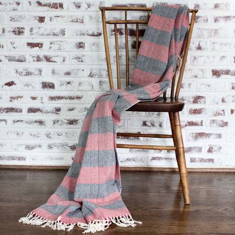 BELLA hand woven blanket in strip design hand crafted by Living Threads Co. partner artisans in red and navy