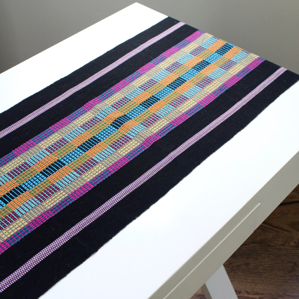Vero handwoven naturally dyed table runner by Living Threads Co. artisans in Guatemala in black