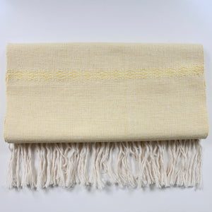 Hand woven Living Threads Co. cotton table runner in yellow