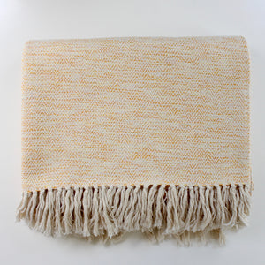 LIA hand woven herringbone cotton throw in natural and tangerine by Living Threads Co. artisans