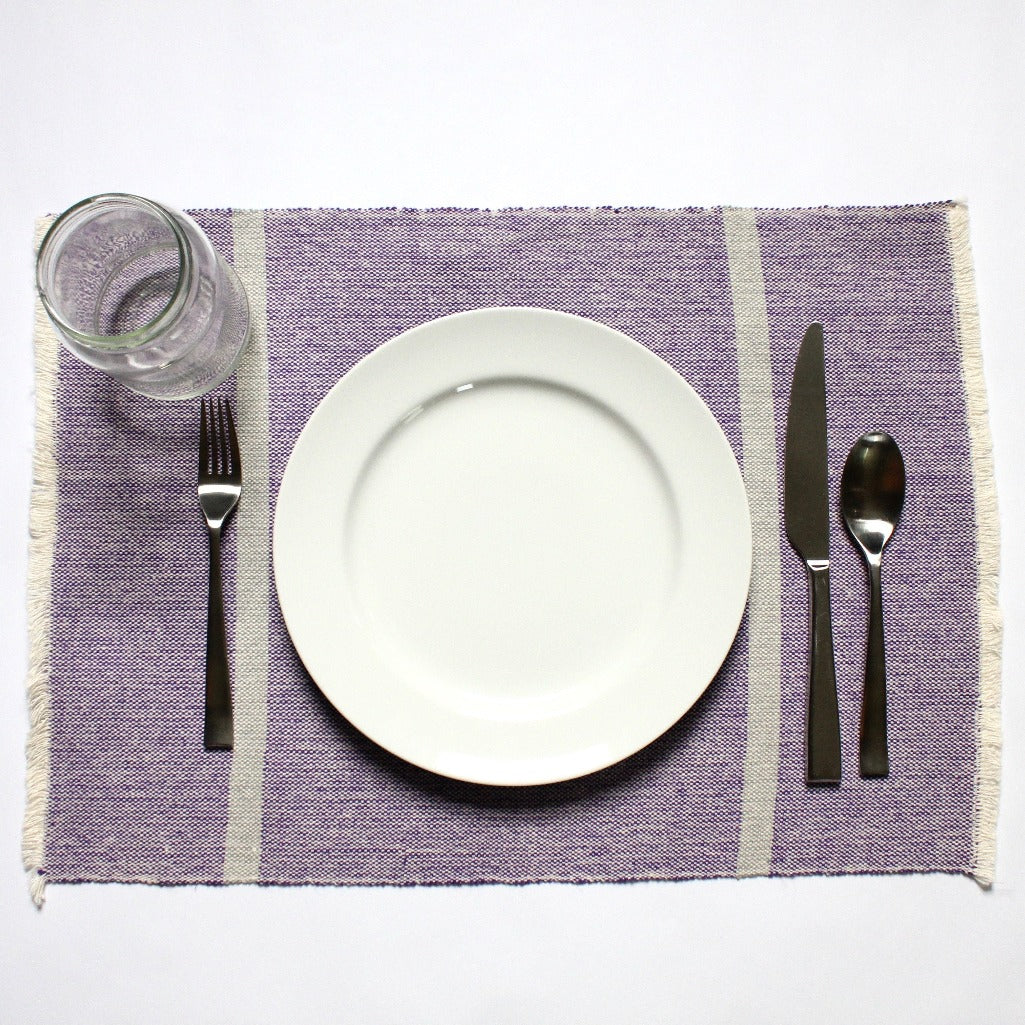 INDI purple and grey striped placemats woven by hand with 100% ecologically dyed cotton by Living Threads Co.