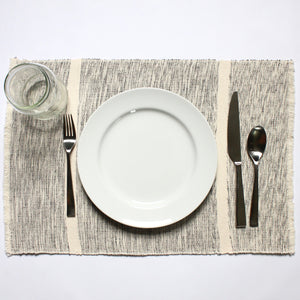 INDI mixed grey and natural striped placemats woven by hand with 100% ecologically dyed cotton by Living Threads Co.